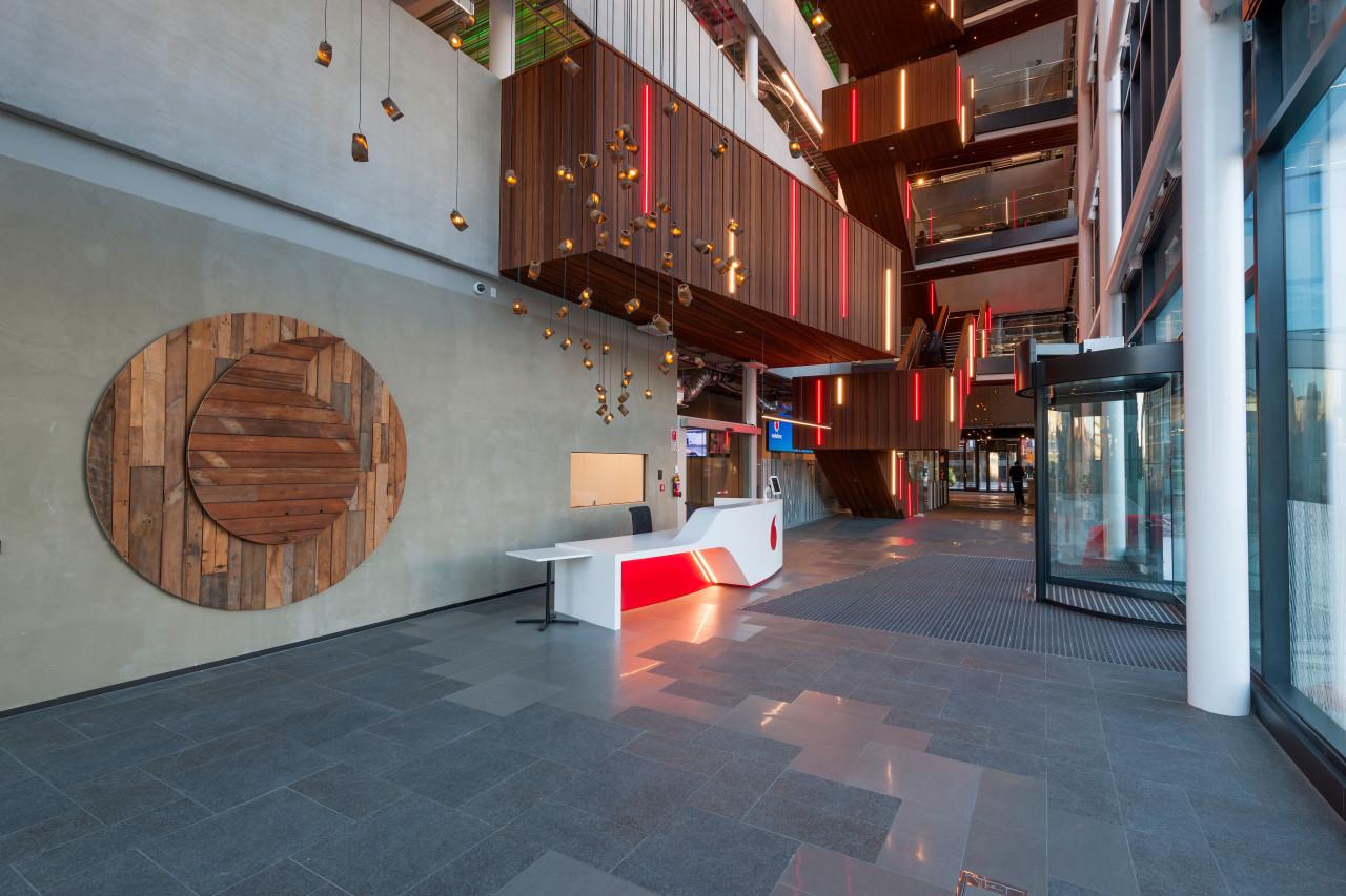 The Vodafone InnoV8 buildings soaring atrium clad in architecture, floor, flooring, interior design, lobby, tourist attraction, gray
