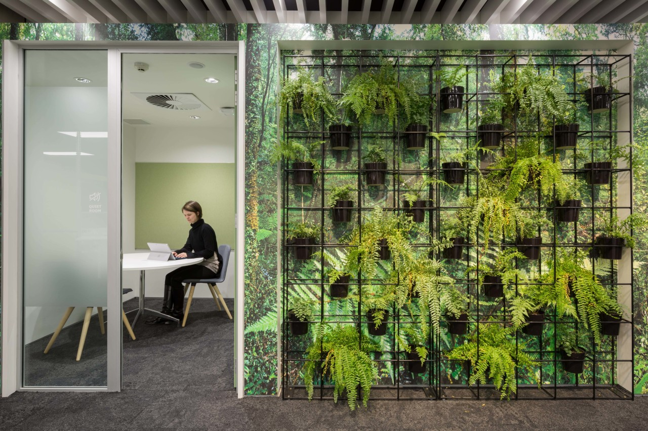These quiet rooms are fronted by a architecture, grass, green, plant, tree, gray