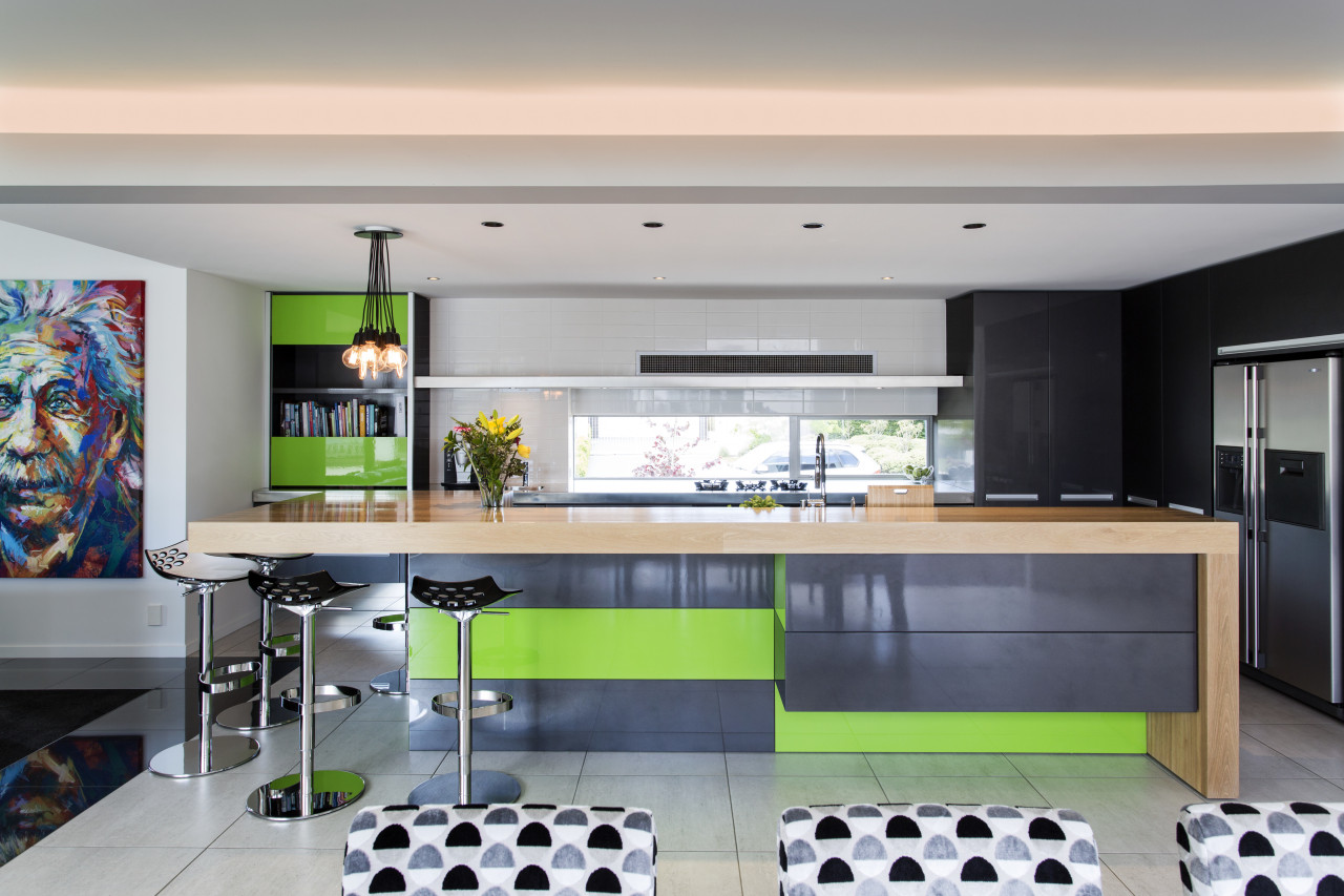 Contrasting metallic lime green and charcoal cabinetry faces countertop, interior design, kitchen, gray