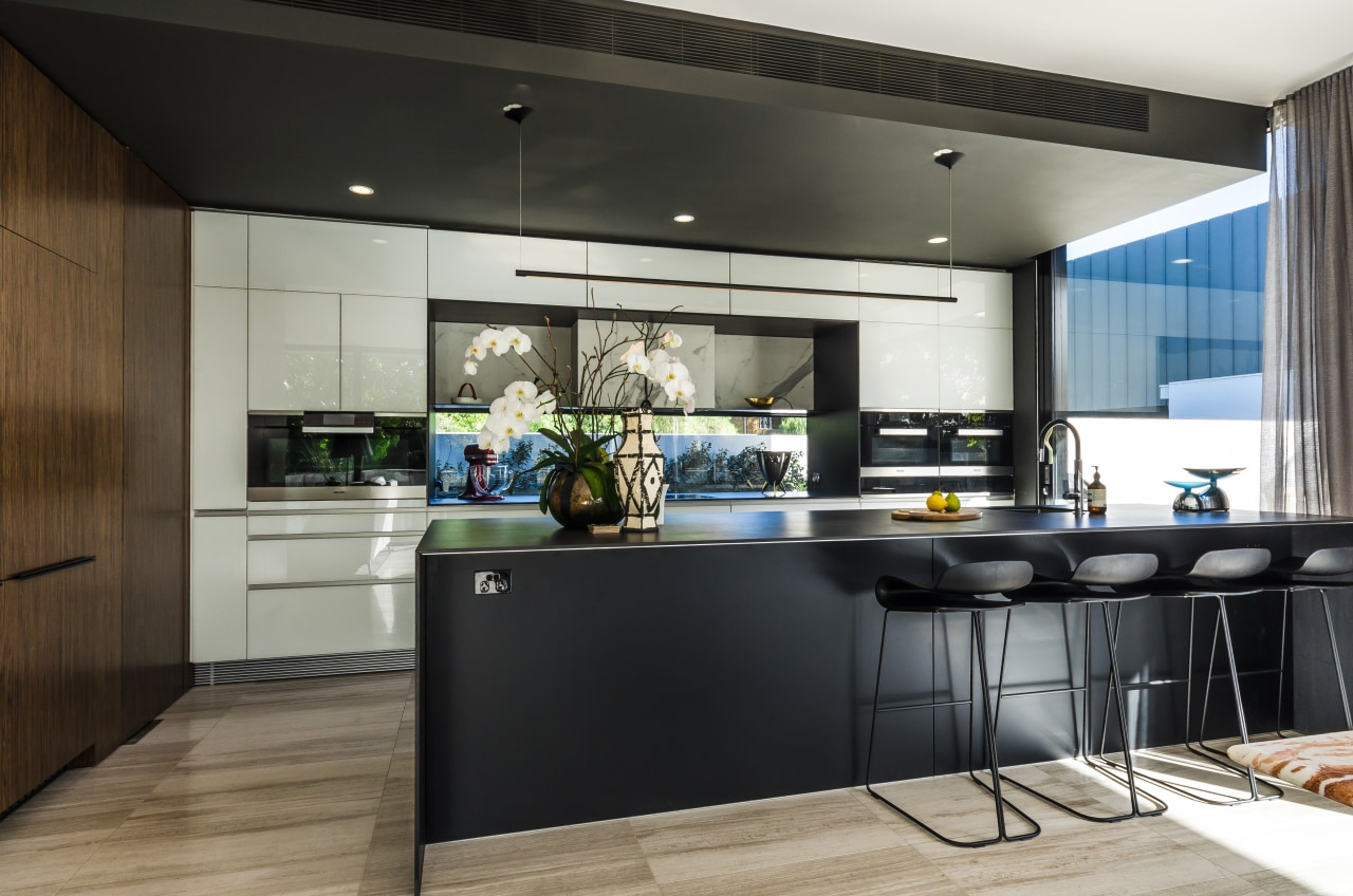 Rear wall cabinetry in white glass with a cabinetry, countertop, cuisine classique, interior design, kitchen, black, gray