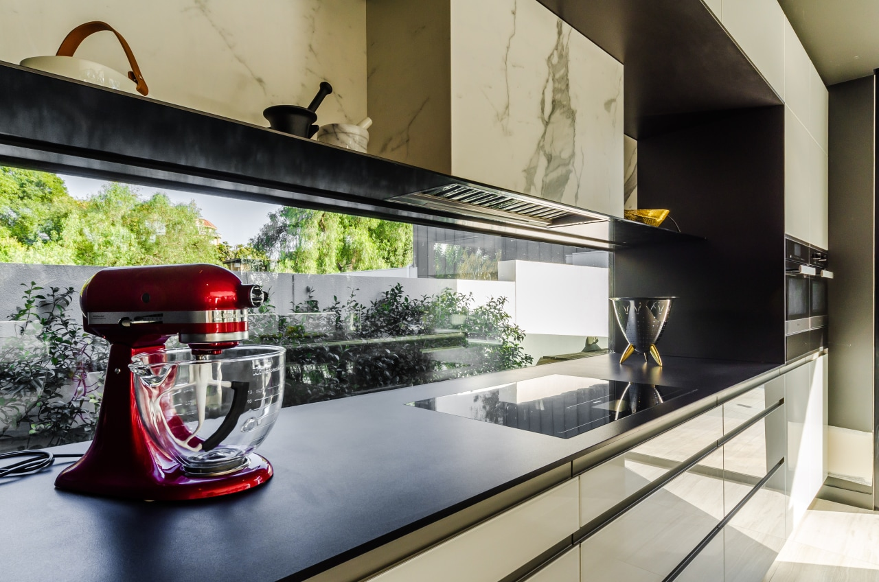 This kitchen is by Pepper Design. Photography by countertop, interior design, gray, black