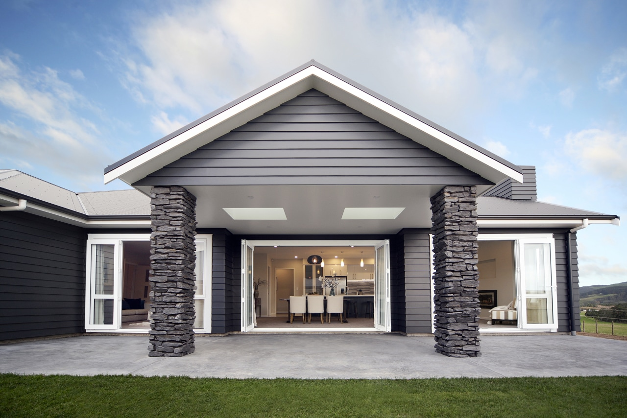 French and bifold doors open to a spacious building, elevation, estate, facade, home, house, property, real estate, residential area, roof, siding, gray, white