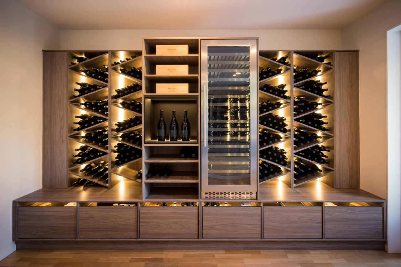 This sculptural, furniture-like wine display responds directly to furniture, wine cellar, wine rack, winery, brown