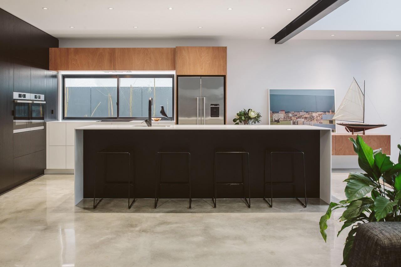 This kitchens slender Glacier White countertops underscore its furniture, interior design, kitchen, gray