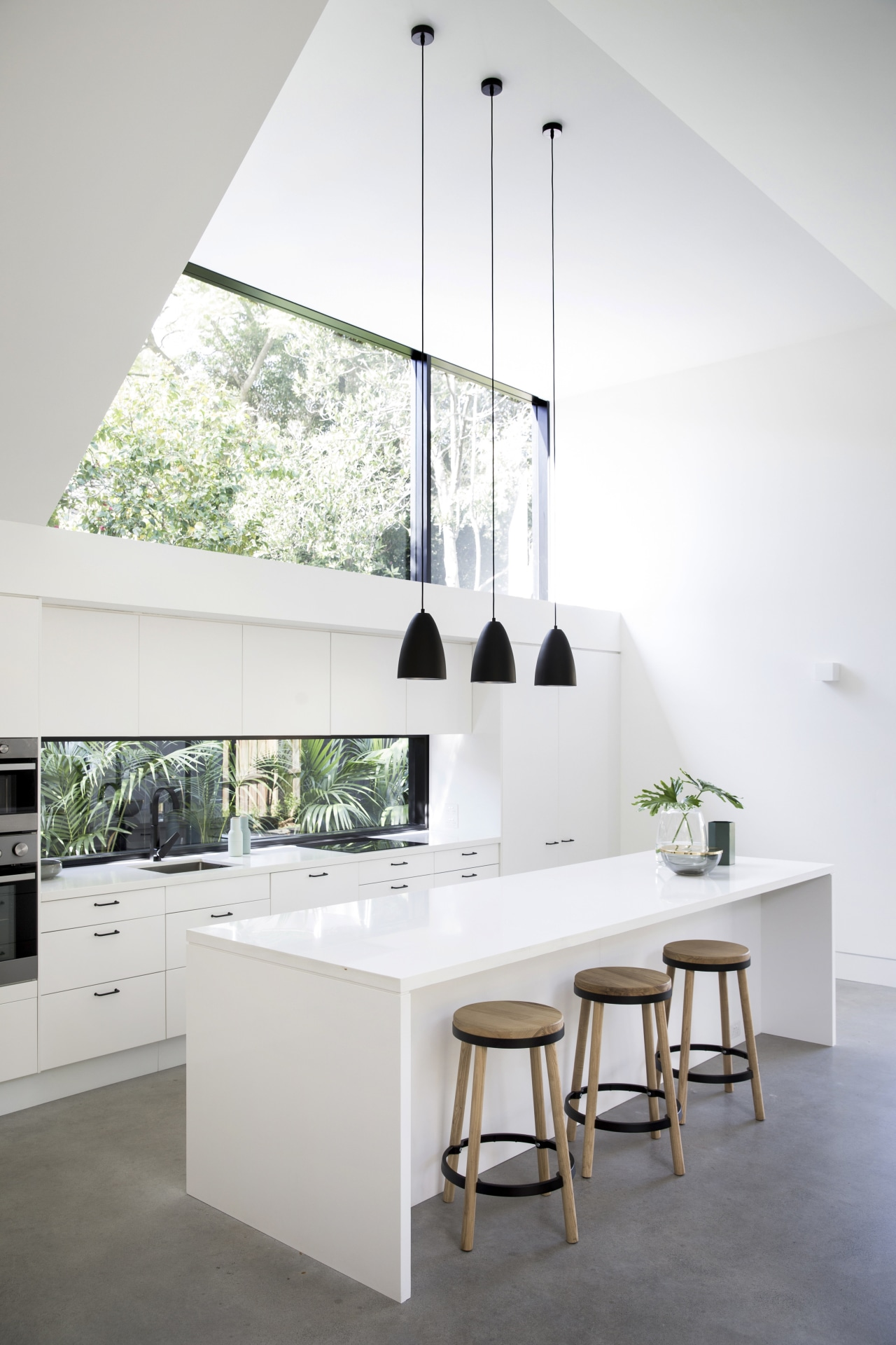 Architect Eva-Marie Prineas prioritised the owners modest renovation architecture, countertop, daylighting, floor, furniture, home, house, interior design, kitchen, product design, table, white