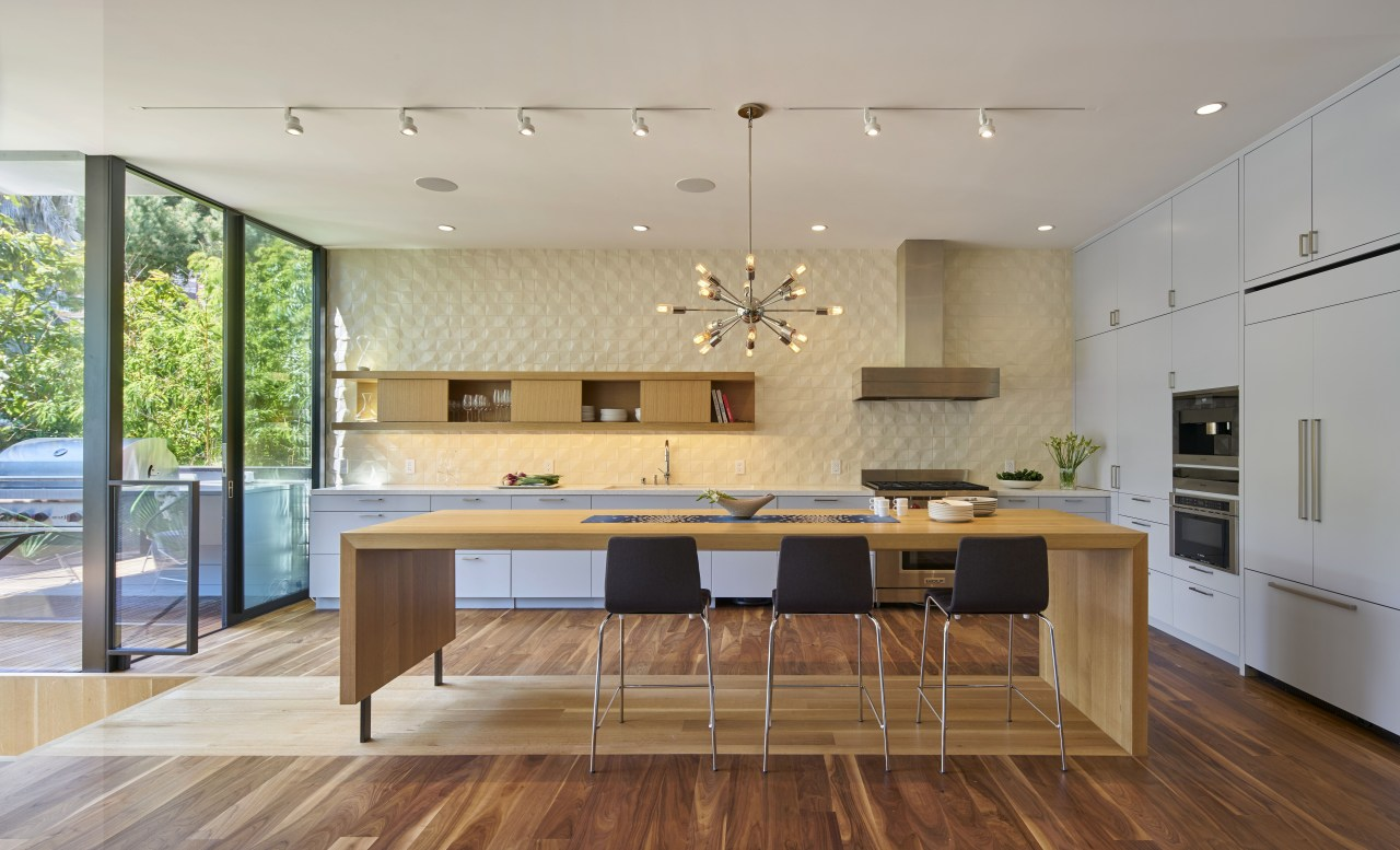 When is an island not an island? When architecture, ceiling, countertop, floor, flooring, hardwood, house, interior design, interior designer, kitchen, laminate flooring, room, table, wood flooring, gray