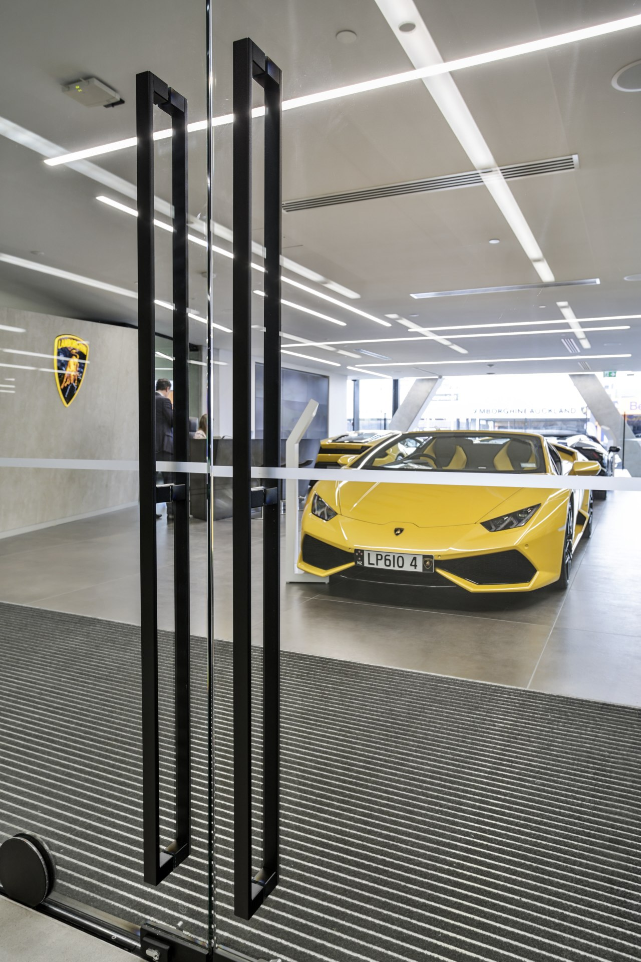 Whats in a touch? Well, quite a lot automotive design, car, car dealership, luxury vehicle, motor vehicle, sports car, vehicle, yellow, gray
