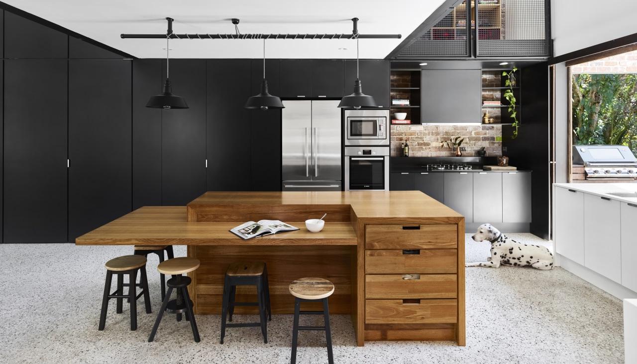 Concrete floors ensure a semi-industrial feel. countertop, cuisine classique, furniture, interior design, kitchen, table, white, black