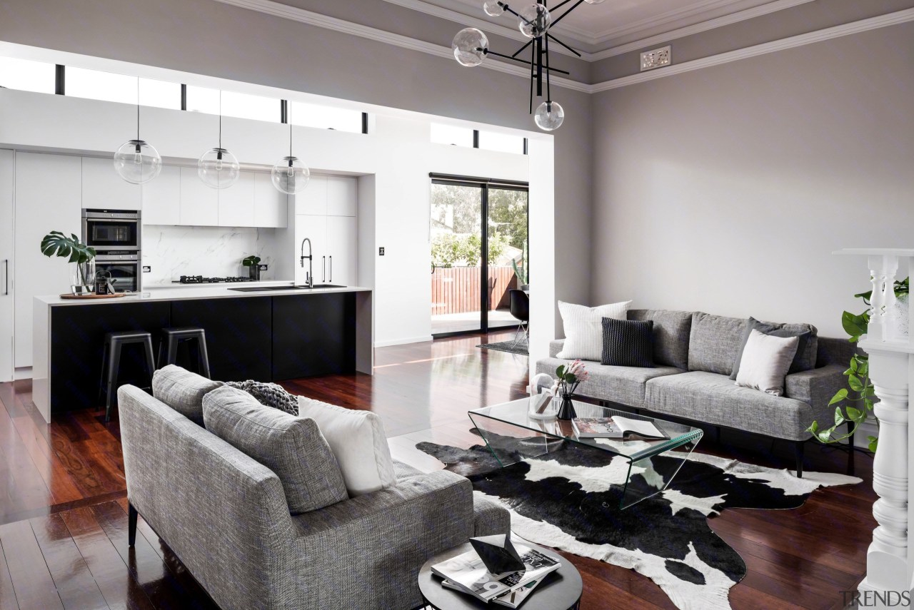 This home by Dalecki Design was redesigned floor, home, interior design, living room, property, real estate, room, white, gray
