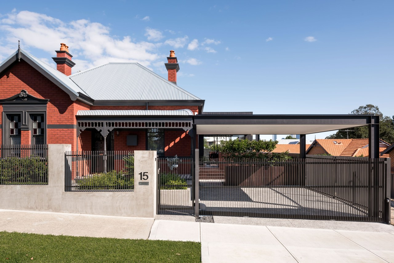 A new clean-lined carport provides the main hint architecture, estate, facade, home, house, outdoor structure, property, real estate, residential area, roof, white