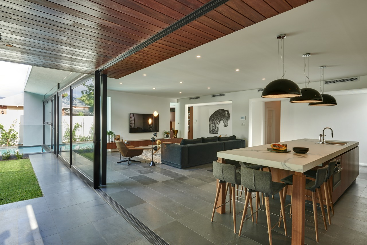 This kitchens wood veneer cabinetry connects with the ceiling, house, interior design, real estate, gray
