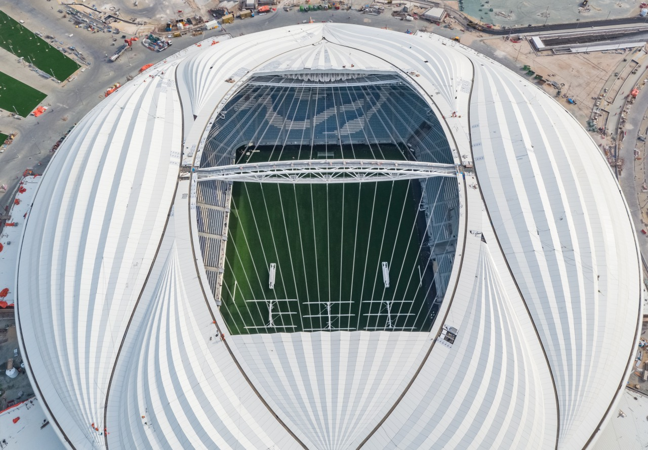A bird's eye view of the high-tech, high-profile aerospace engineering, daylighting, grass, infrastructure, sport venue, stadium, vehicle, white, gray