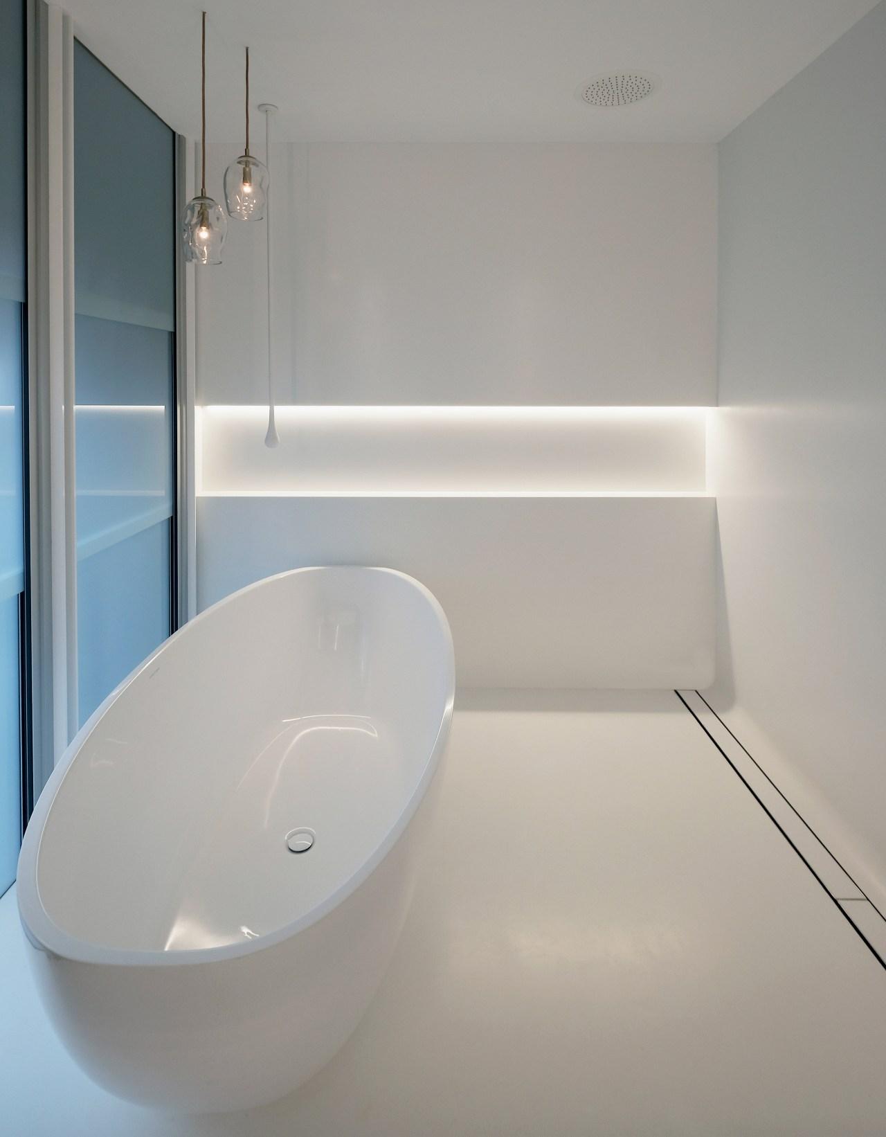 Coloured glass frameless sash windows open this bathroom architecture, bathroom, bathtub, ceramic, floor, flooring, glass, house, interior design, material property, plumbing fixture, property, room, tap, tile, toilet, wall, gray