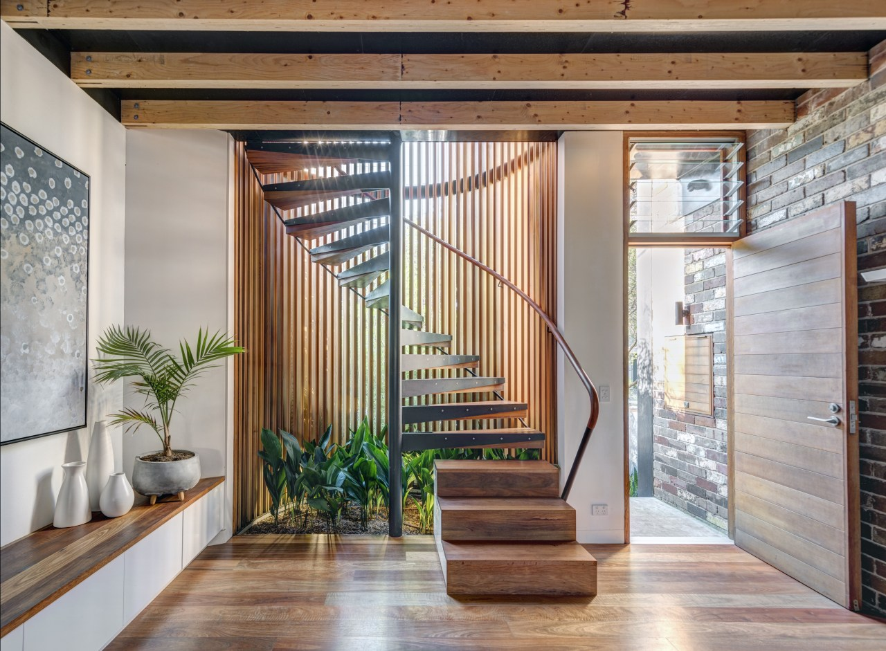 The house combines innovative architectural design with near architecture, door, facade, home, house, interior design, lobby, real estate, stairs, window, wood, gray