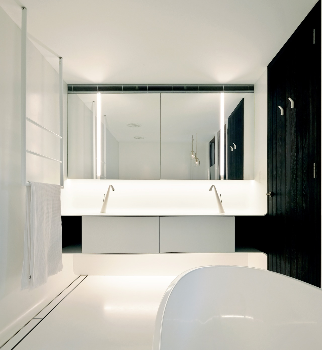 """""""For this bathroom, we chose a continuous Corian architecture, bathroom, bathroom accessory, bathtub, building, ceiling, floor, flooring, furniture, glass, house, interior design, material property, plumbing fixture, property, room, sink, tap, tile, white, gray"""