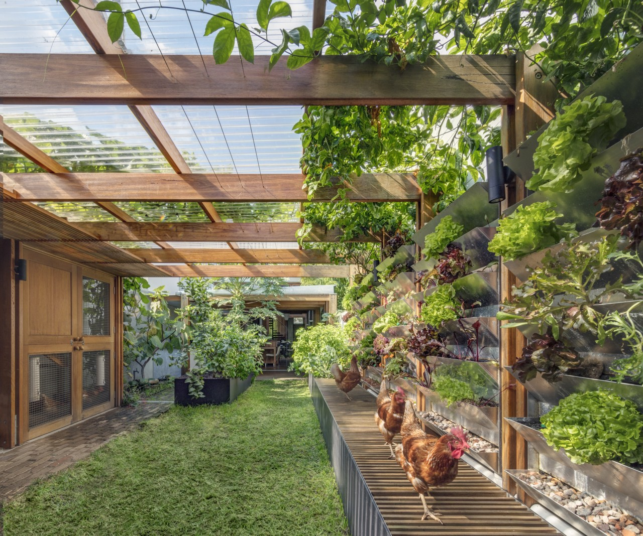 The rear garden yields the majority of the backyard, courtyard, outdoor structure, pergola, plant, real estate, tree, yard, brown