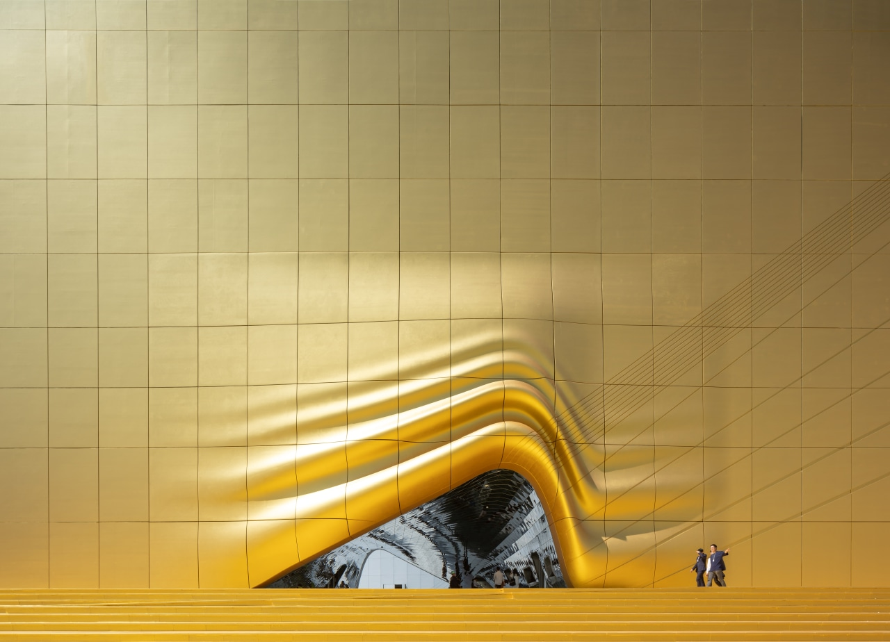 A splash of gold at the entrance to angle, ceiling, floor, flooring, line, tile, wall, yellow, orange, brown
