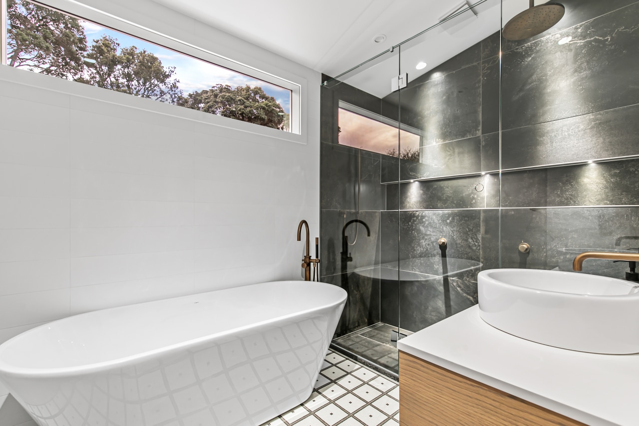 The freestanding bath is sited in the old