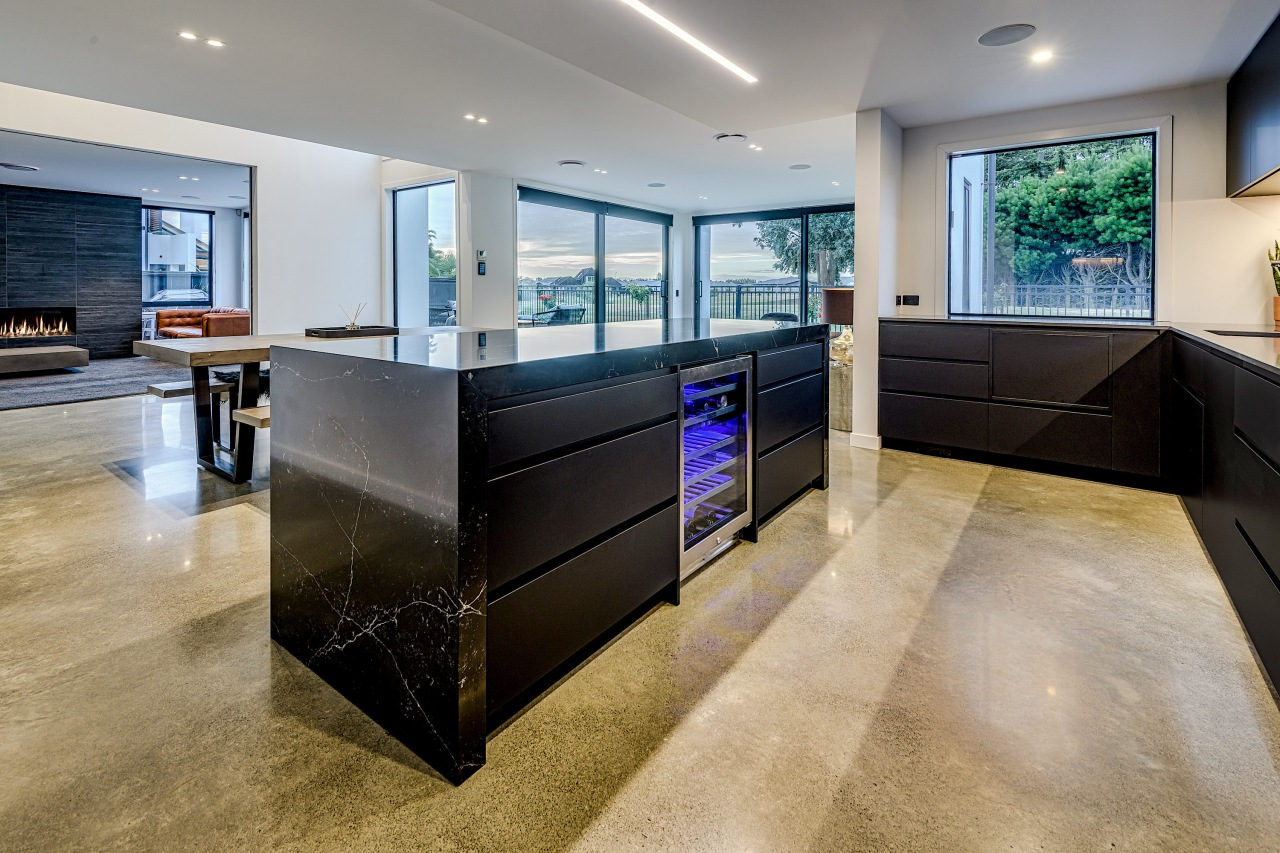 Polished concrete floors anchor this dark kitchen without architecture, building, cabinetry, ceiling, countertop, design, floor, flooring, furniture, glass, home, house, interior design, kitchen, living room, material property, property, real estate, room, tile, wall, gray