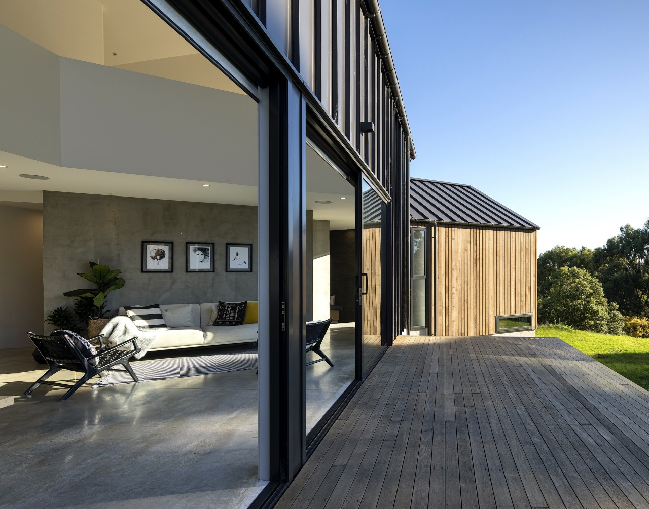 The main ground floor steps gently down the apartment, architecture, building, concrete, courtyard, deck, design, estate, facade, floor, home, house, interior design, property, real estate, residential area, roof, siding, wall, wood, gray, black