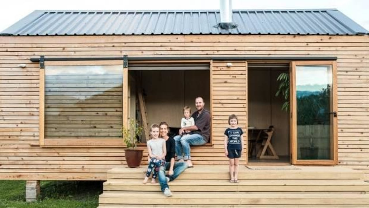 Francois and Sarah-Lee Guittenit of Nelson in cottage, home, house, log cabin, shack, shed, siding, window, wood, orange