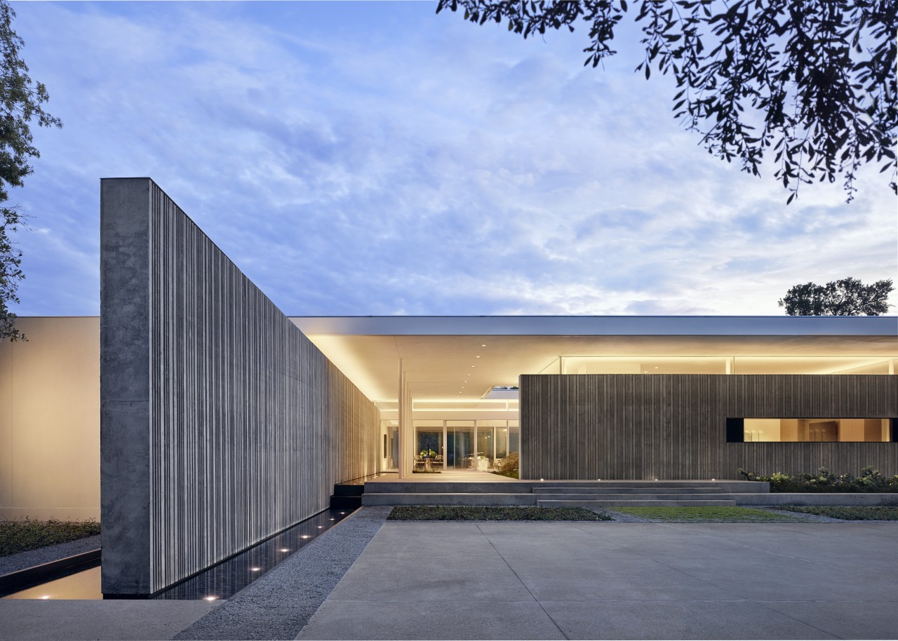 Heavy cast-concrete walls extend from the interior of