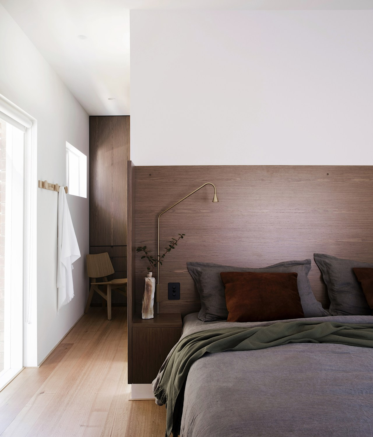 Walnut joinery features throughout the home, including on