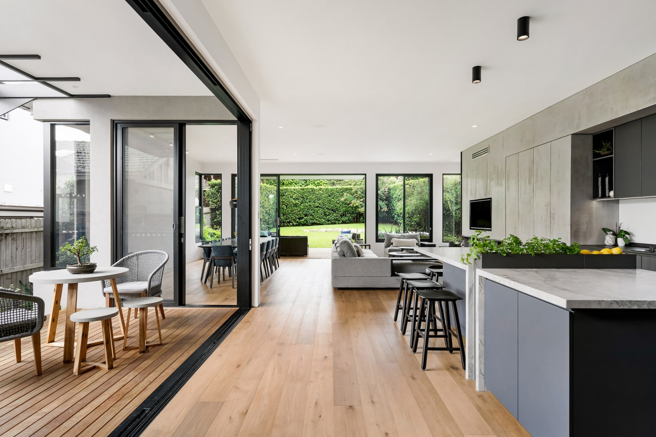 Expansive glazing, white walls and pale wood floors