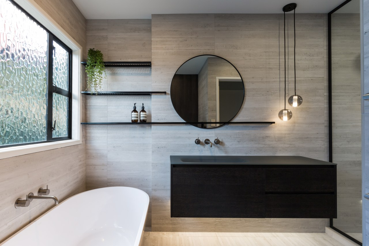 This bathroom renovation feels large and open bathroom, countertop, floor, flooring, interior design, room, sink, wall, gray