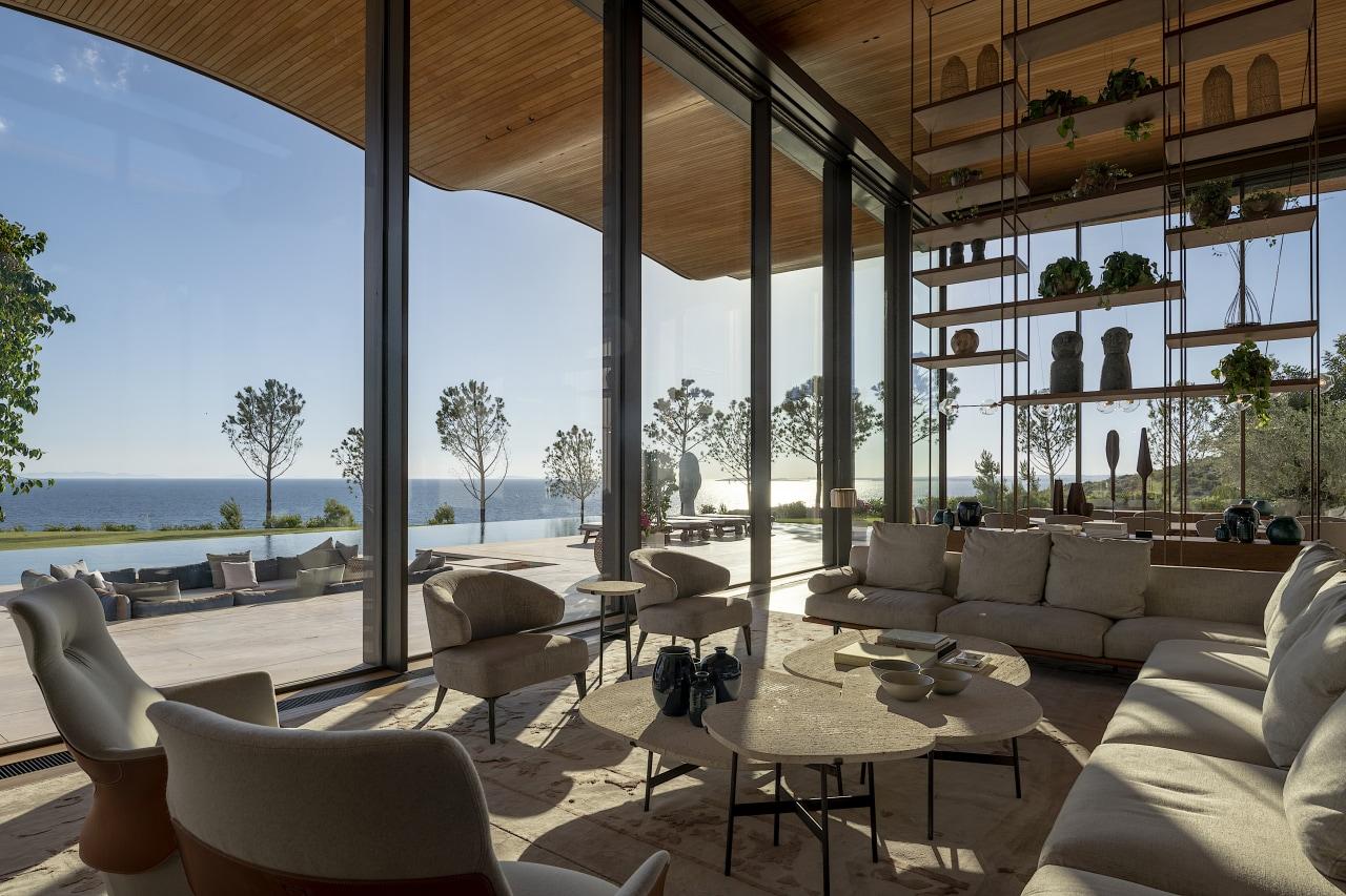 Large glass doors along this villa's façade slide