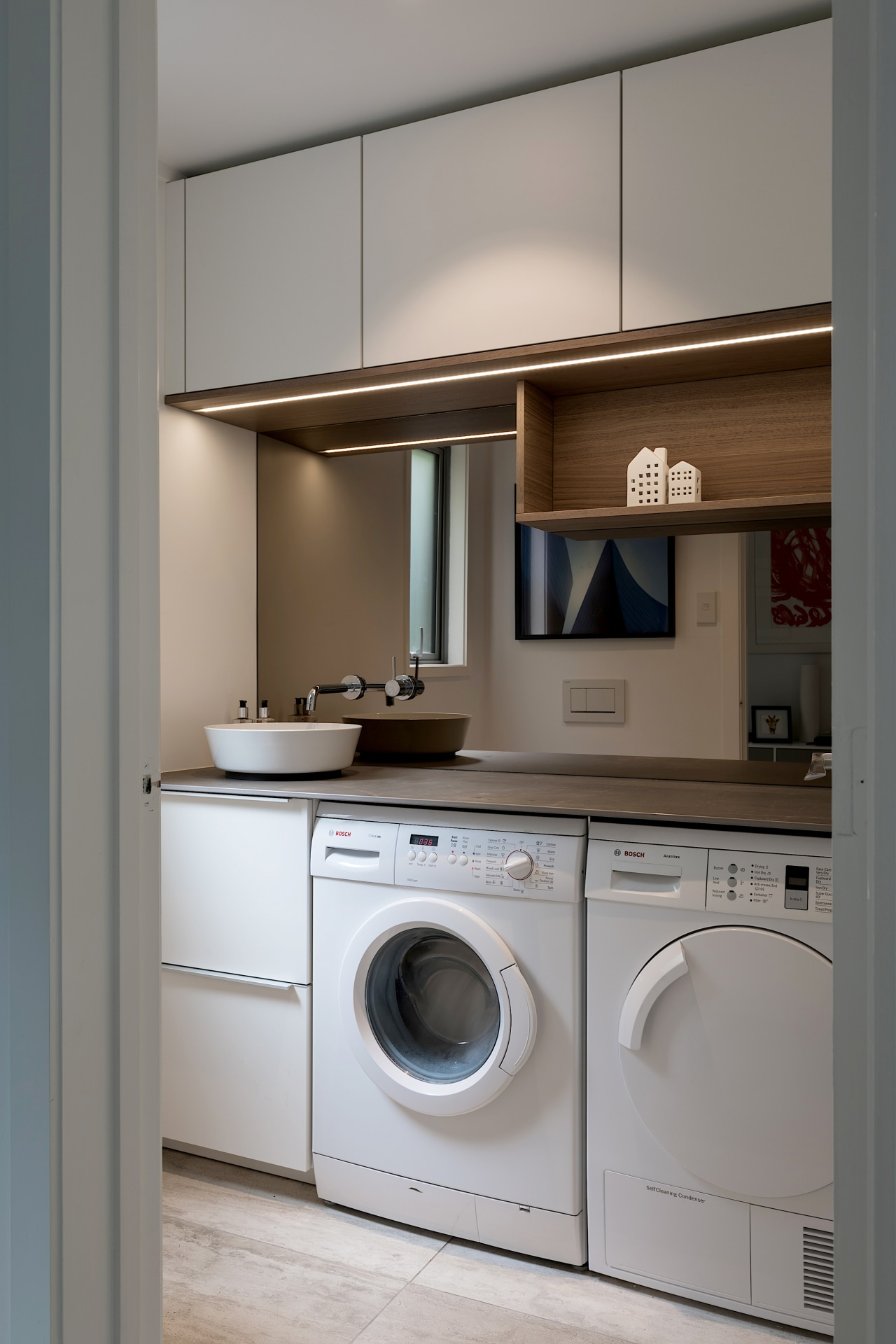 Designer Lara Farmillo designed the laundry in this architecture, building, cabinetry, clothes dryer, countertop, cupboard, floor, furniture, home appliance, house, interior design, kitchen, laundry, laundry room, major appliance, material property, property, room, washing machine, gray