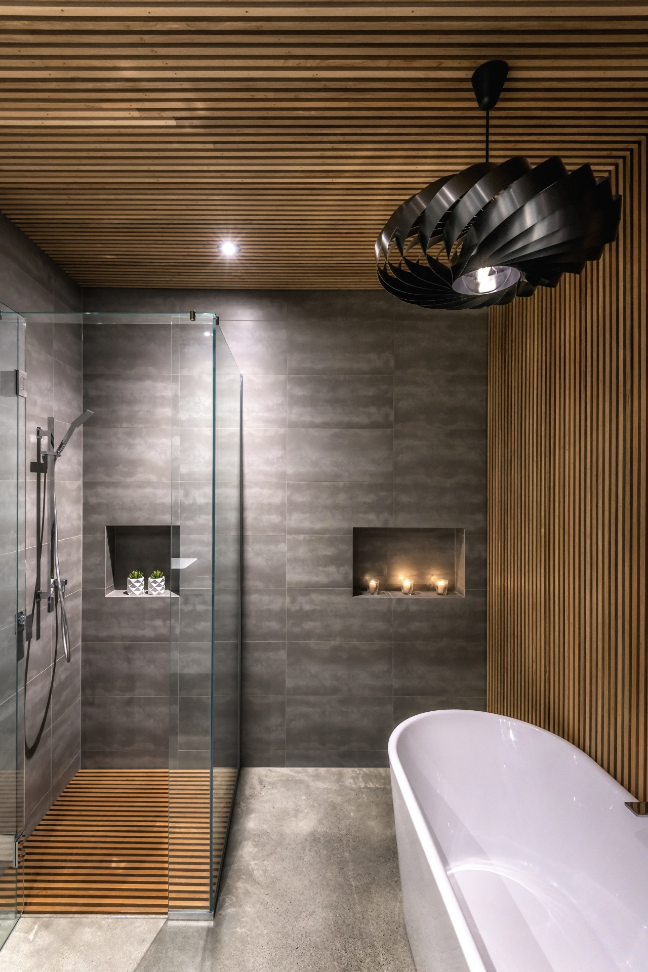 In the bathroom, the tiled areas incorporate custom architecture, bathroom, building, ceiling, floor, flooring, home, house, interior design, lighting, property, real estate, room, tile, wall, brown, gray