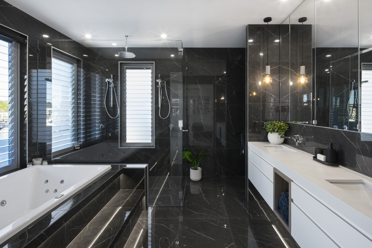The dark, moody tones of this elegant ensuite apartment, architecture, bathroom, building, cabinetry, ceiling, countertop, floor, flooring, furniture, glass, home, house, interior design, plumbing fixture, property, real estate, room, sink, tile, black, gray