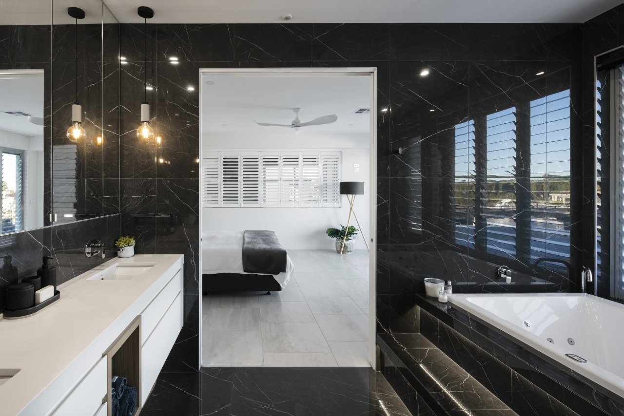The black-and-white bathroom complements the adjacent master bedroom. apartment, architecture, bathroom, black-and-white, building, ceiling, countertop, design, floor, flooring, furniture, glass, home, house, interior design, loft, property, real estate, room, tile, black, gray