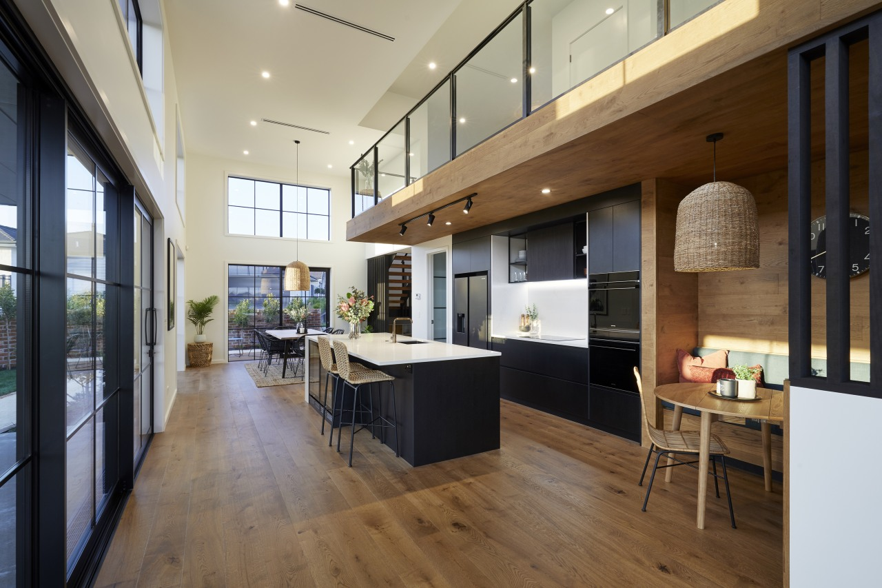 The orientation of the warm wood flooring accentuates