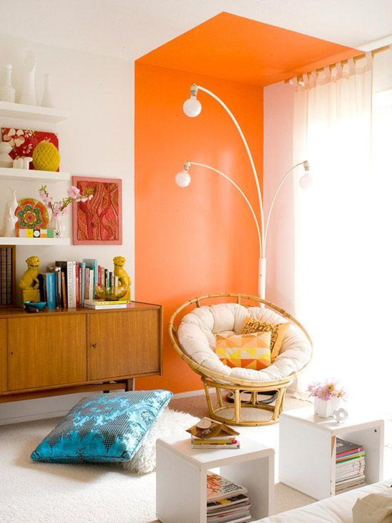 While open plan living remains ever popular, we building, furniture, home, house, interior design, living room, orange, peach, pink, room, shelf, shelving, table, wall, yellow, white, orange