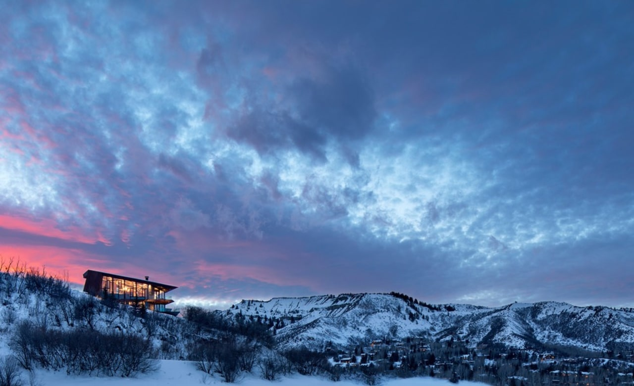 This all-weather mountain retreat is designed for recharging afterglow, atmosphere, cloud, dawn, dusk, evening, fell, freezing, geological phenomenon, horizon, landscape, meteorological phenomenon, morning, mount scenery, mountain, mountain range, sky, snow, sunlight, sunrise, sunset, tree, winter, blue, teal
