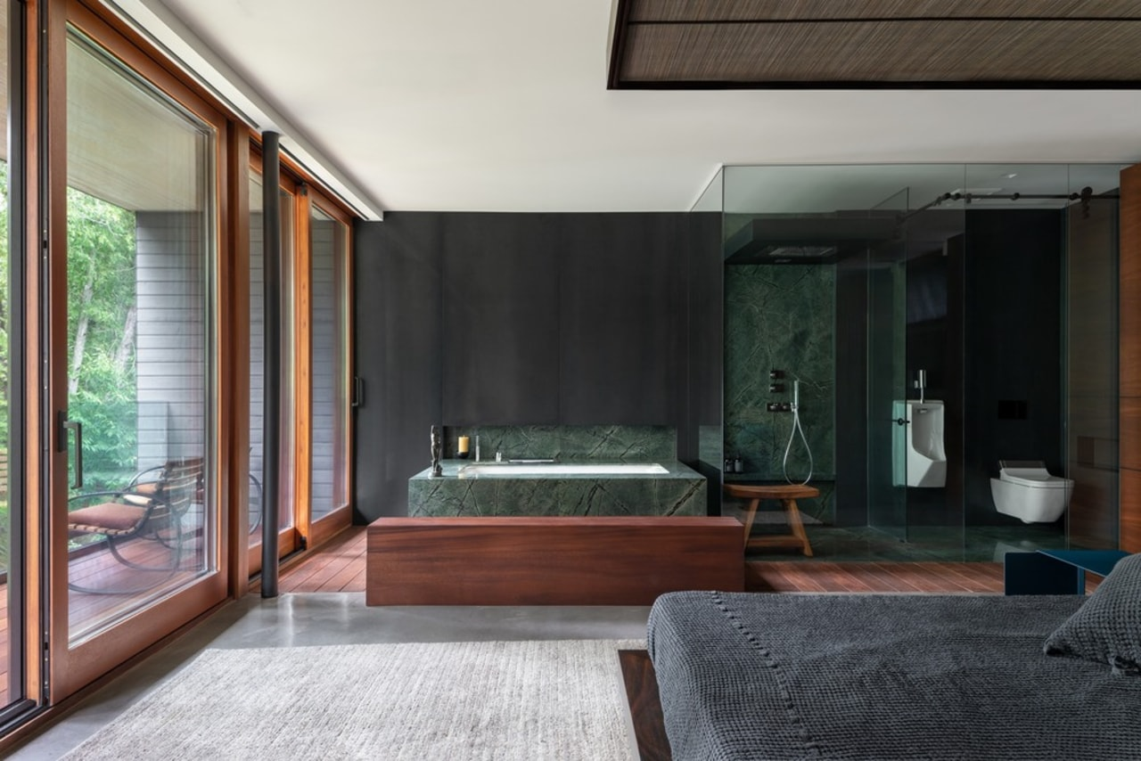 The master bedroom with open ensuite bathroom, and architecture, bed, bedroom, boutique hotel, building, ceiling, floor, furniture, hardwood, home, house, interior design, living room, loft, property, real estate, room, suite, black, gray