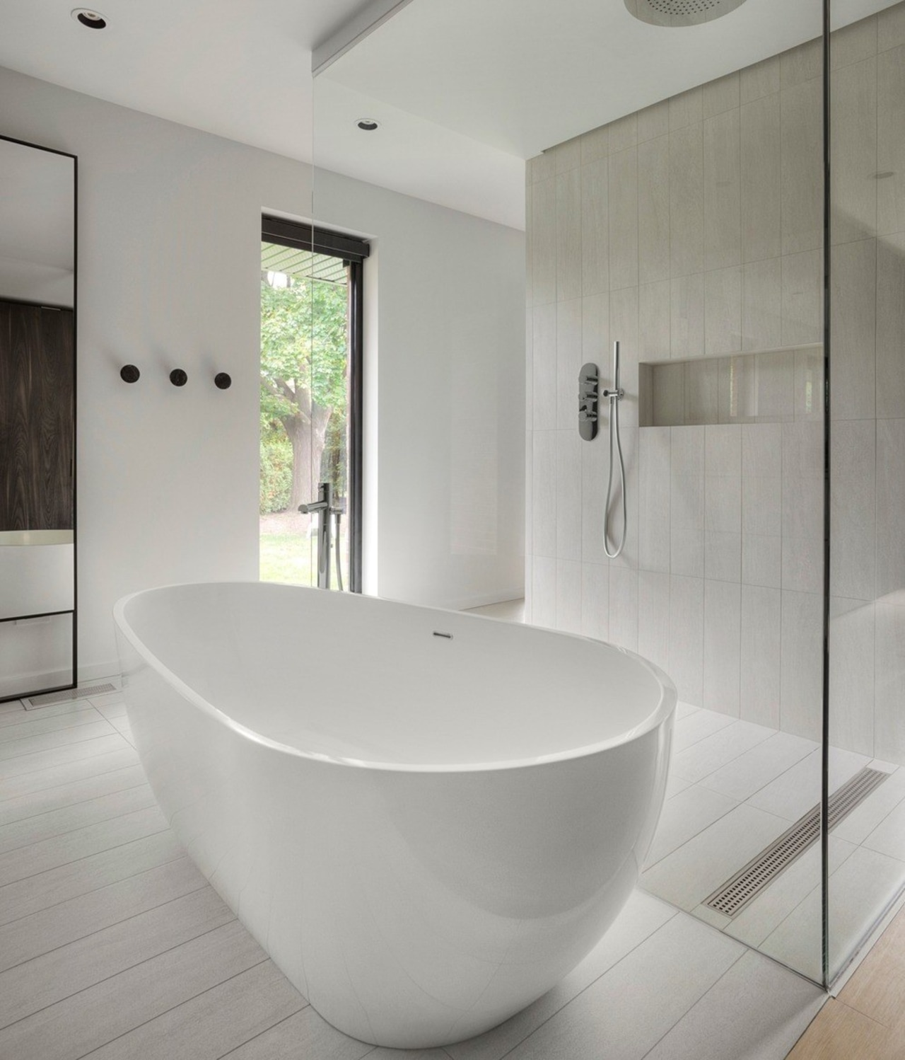 The freestanding bath tub in front of the architecture, bathroom, bathtub, building, ceiling, ceramic, floor, flooring, house, interior design, marble, material property, plumbing fixture, property, room, tap, tile, gray