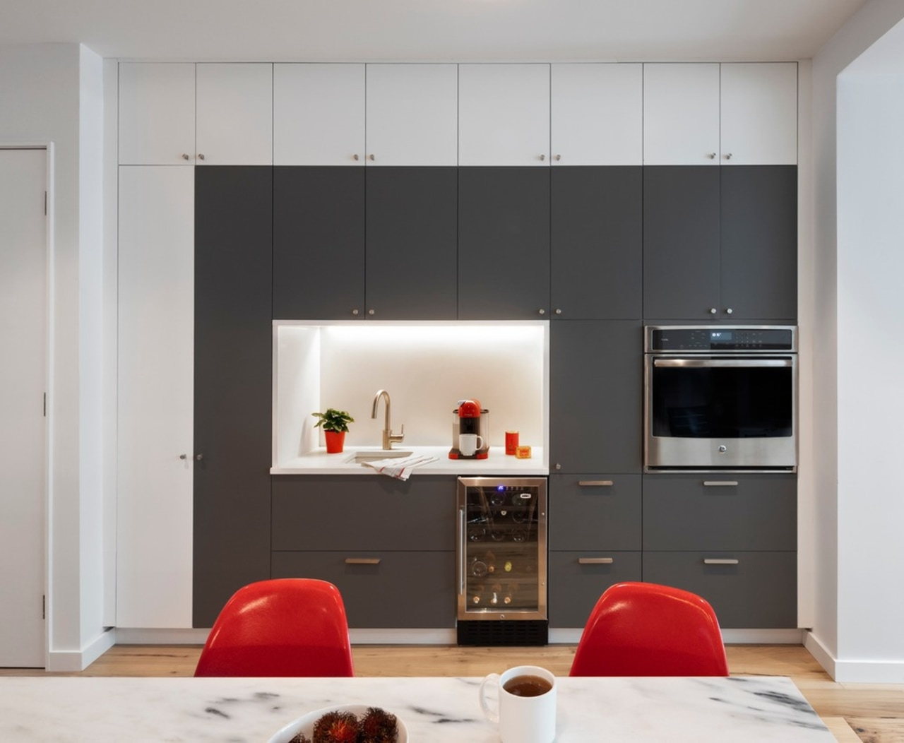Ikea boxes with site-fabricated gray and white painted building, cabinetry, ceiling, cupboard, door, floor, flooring, furniture, hearth, home, house, interior design, laminate flooring, living room, material property, property, red, room, table, wall, wardrobe, gray, black