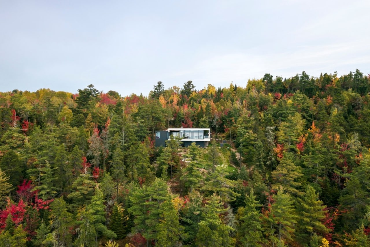 The house sits delicately on a narrow escarpment autumn, biome, conifer, forest, leaf, natural environment, nature, pine family, plant, plant community, shrubland, sky, temperate broadleaf and mixed forest, tree, tropical and subtropical coniferous forests, vegetation, wilderness, woody plant, brown, white