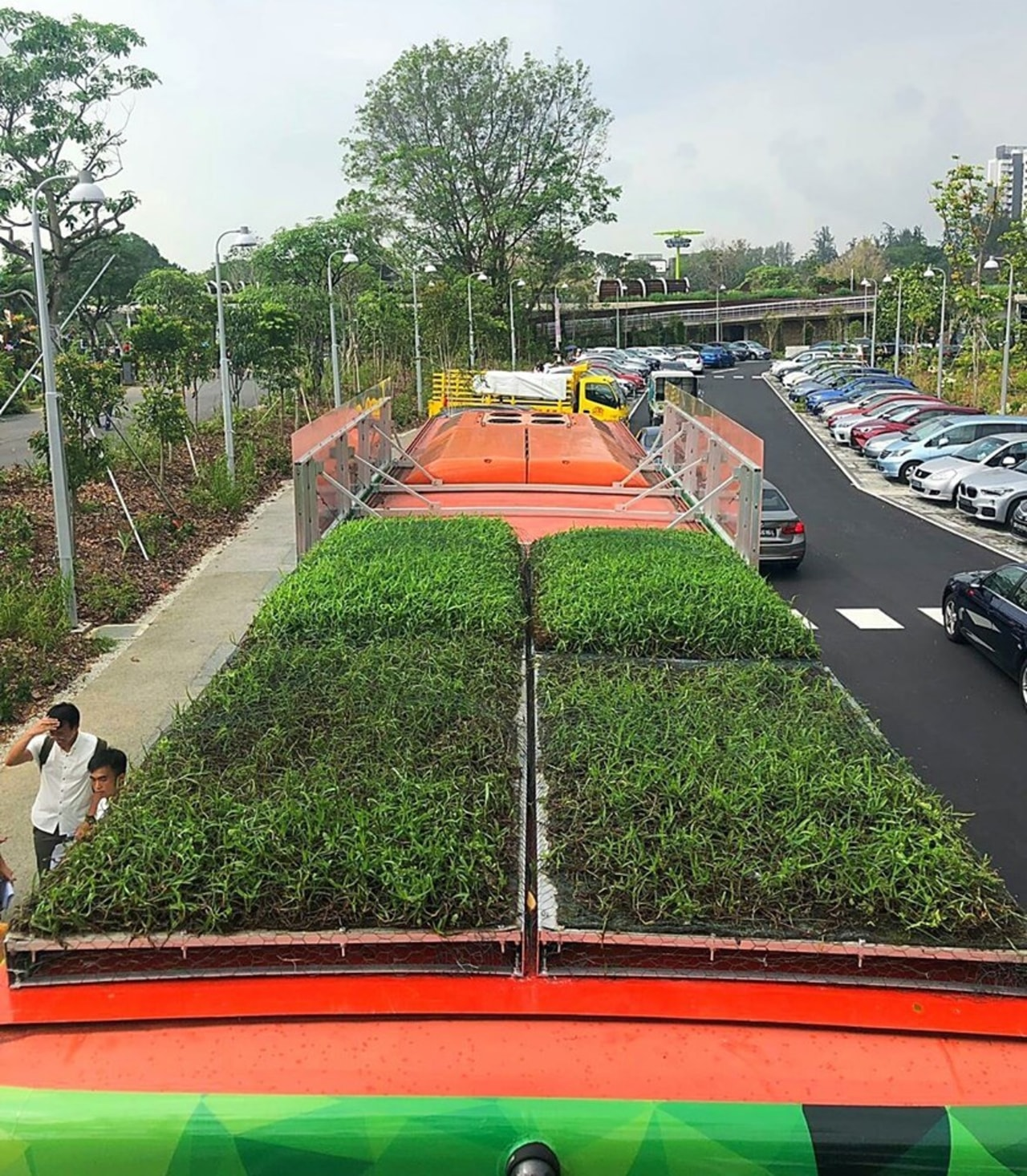 Outfitted with an innovative, locally developed and soil-less asphalt, grass, green, plant, road, shrub, transport, tree, vehicle
