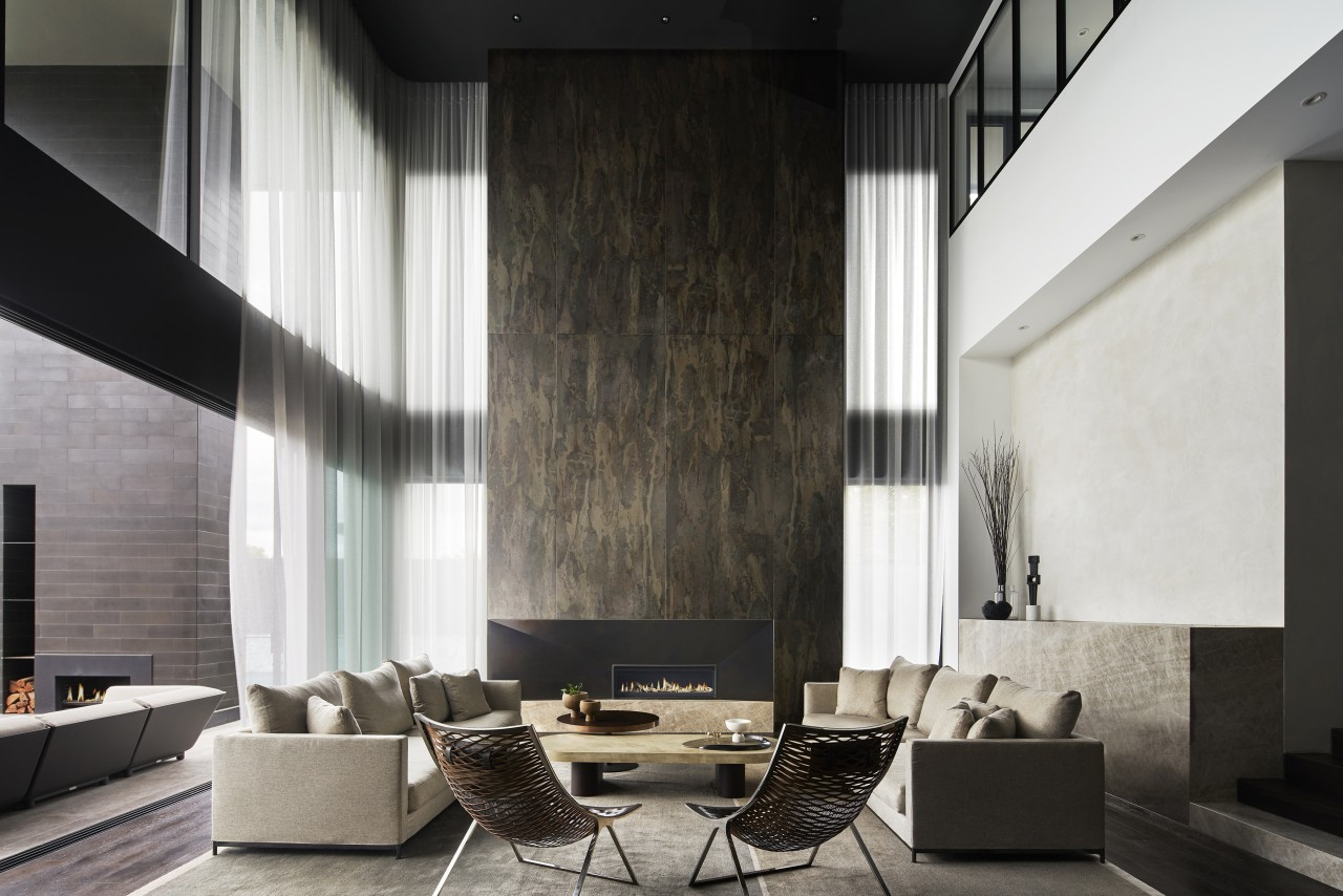 A soaring fire surround and drapes draw the