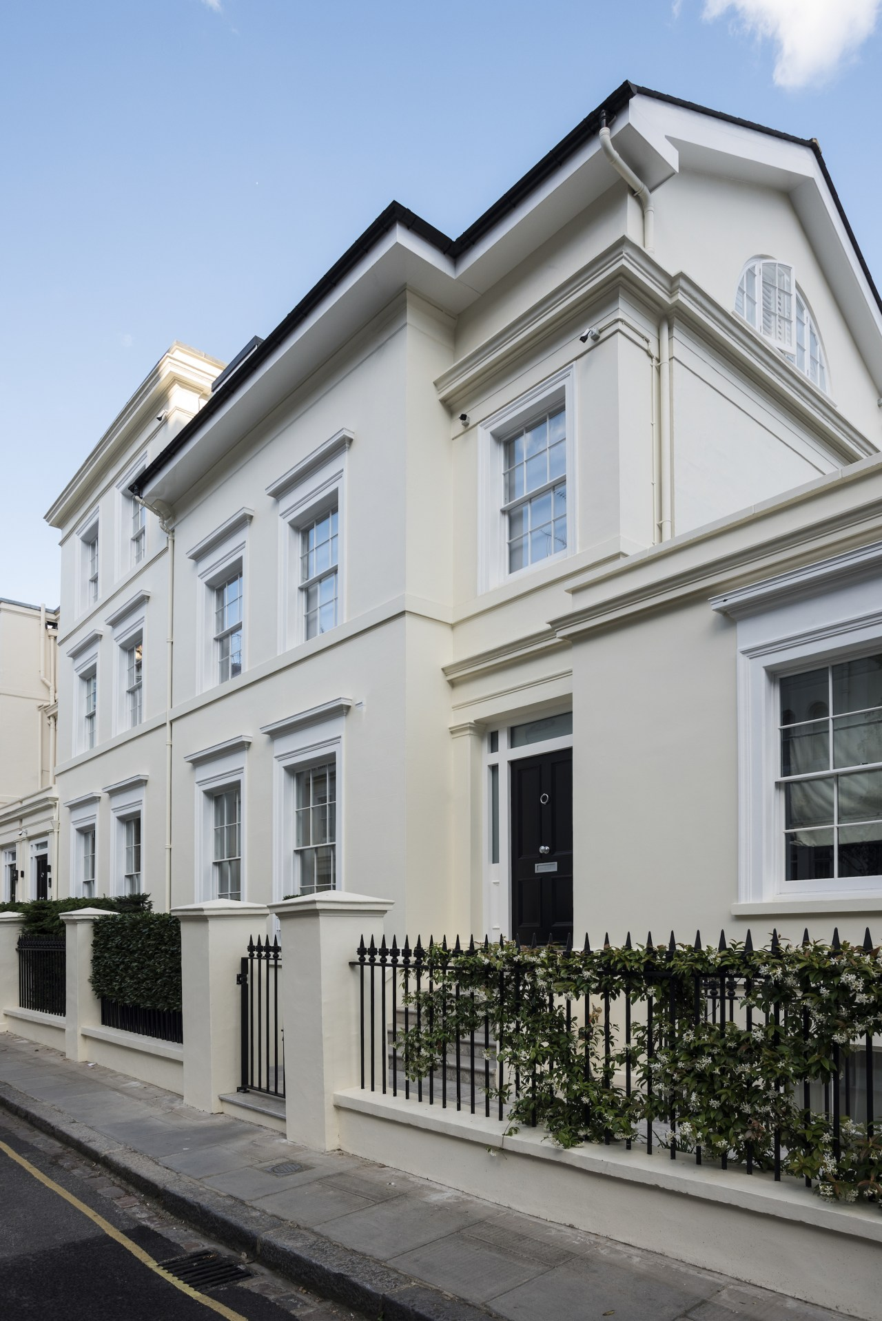 Traditional front doors to two townhouses in well-to-do