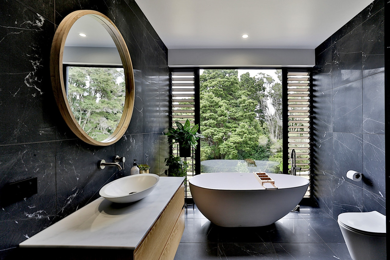 This simple yet striking bathroom lets occupants feel architecture, bathroom, bathtub, building, ceiling, ceramic, floor, flooring, furniture, home, house, interior design, marble, plumbing fixture, property, real estate, room, sink, tap, tile, wall, window, gray, black