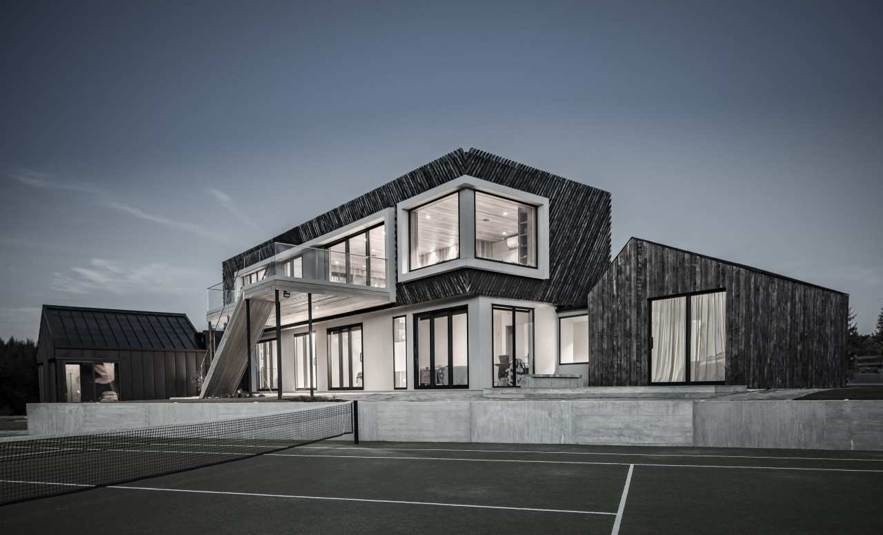This rugged home, by AO Architecture, creates a gray, black