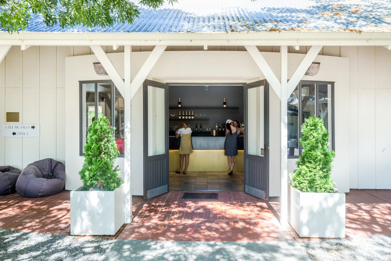 Winner – Palliser Estate Winery Tasting Room by backyard, building, cottage, courtyard, door, estate, facade, home, house, patio, property, real estate, roof, room, shed, white