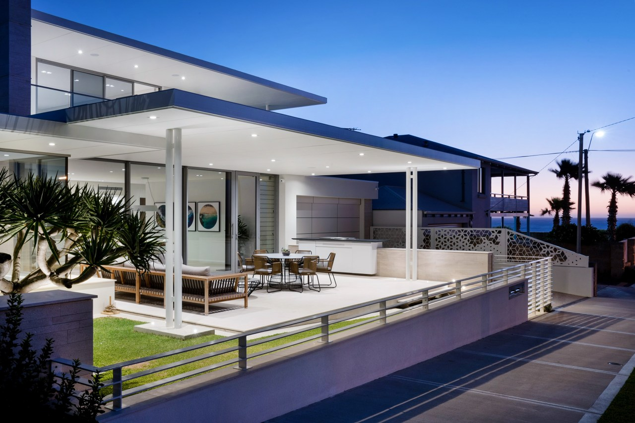 The living area opens through large glass sliding apartment, architecture, building, design, estate, facade, home, house, interior design, property, real estate, residential area, roof, shade, sky, villa, gray