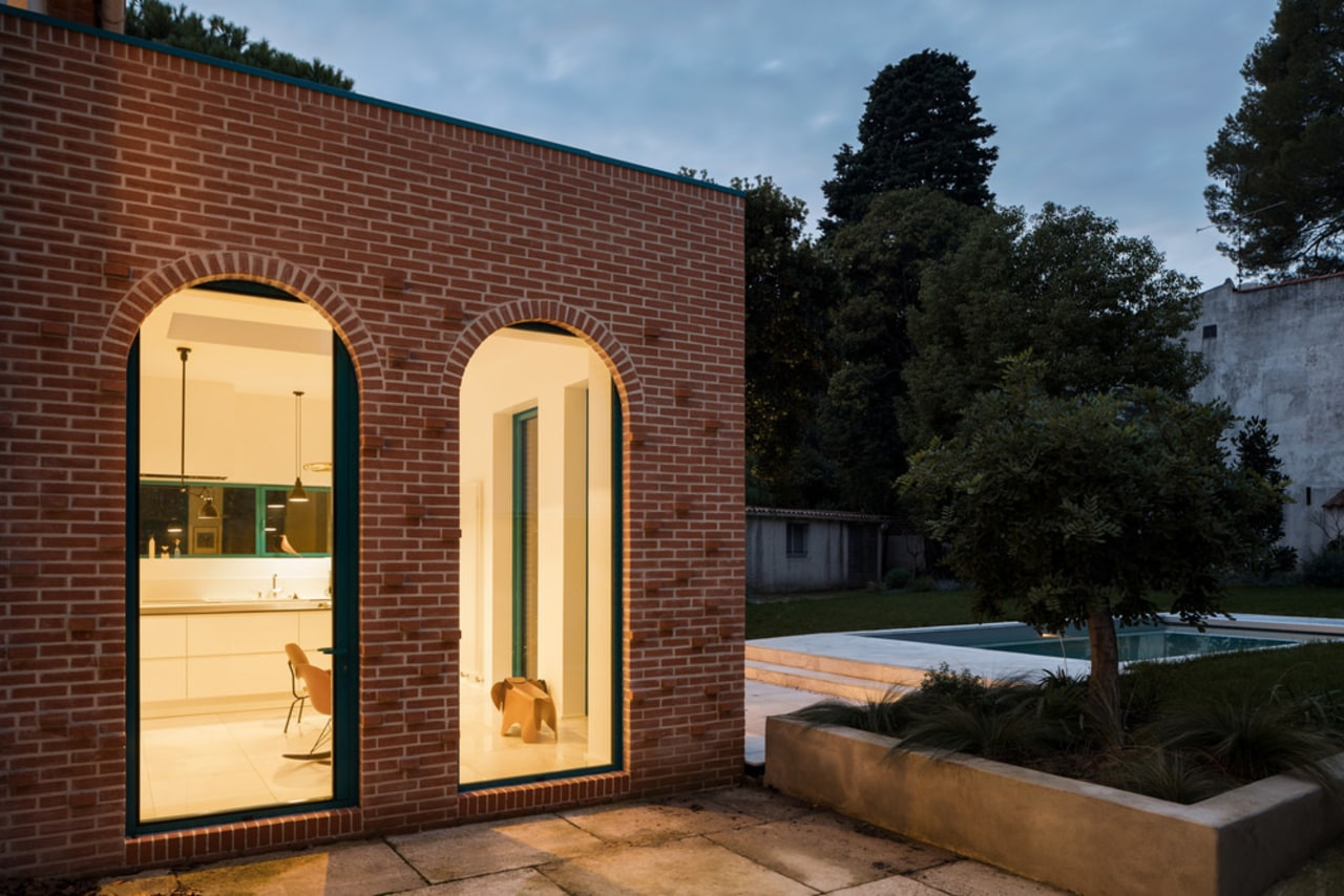 The extension consists of red terracotta bricks. This