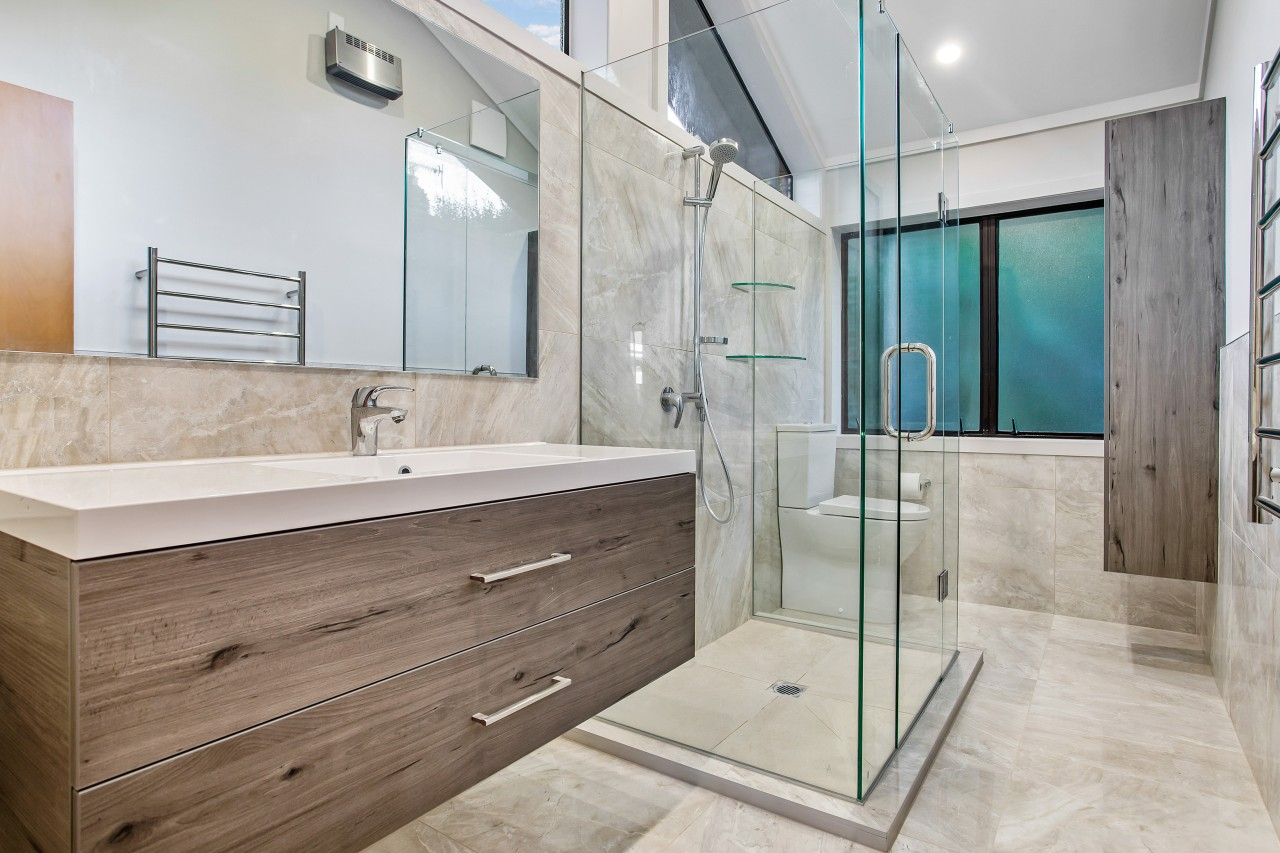 The EJ Building renovation places the shower in architecture, bathroom, bathroom accessory, bathtub, building, ceiling, estate, floor, flooring, furniture, glass, home, house, interior design, material property, plumbing fixture, property, real estate, room, tap, tile, wall, gray